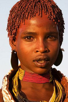 Hamar girl: The Hamar (also spelled Hamer) are an Omotic community inhabiting southwestern Ethiopia. They live in Hamer woreda (or district), a fertile part of the Omo River valley, in the Debub Omo Zone of the Southern Nations, Nationalities, and Peoples Region (SNNPR). They are largely pastoralists, so their culture places a high value on cattle.
