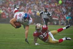 Henry Hynoski gets some air on the drive.    http://www.nydailynews.com/sports/football/giants/ny-giants-san-francisco-49ers-nfc-title-game-candlestick-park-gallery-1.1009993#ixzz1kGAbRbWv    Credits: Ron Antonelli