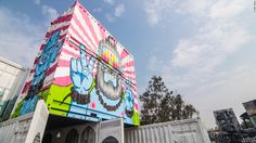 Artist Harsh Raman painted two shipping containers at the Inland Container Depot in his signature style, which is bold, colorful and whimsical.