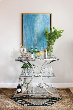 Serve your sippers in style with these sleek, functional carts. And the best part is they're mobile!