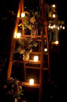 Bride and Bridesmaids bouquets in a mason jar on a ladder with candles!