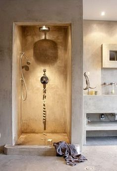 I know it's probably the lighting that is creating the soft warm color. but I love this idea for a simple and stellar color palette for a natural look. Concrete bathroom, shower, via CREATIVE LIVING from a Scandinavian Perspective