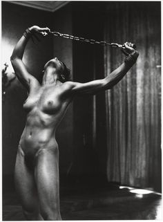 Helmut Newton Lisa Lyon with chains in Paris II, 1980