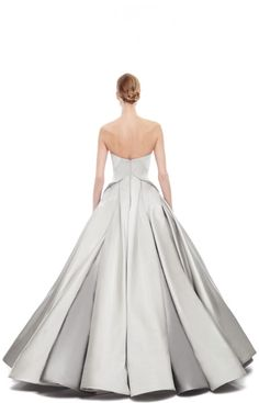 ZAC POSEN Gray Duchess Satin Strapless Gown This strapless dove-grey duchess satin zac posen gown features a bustier-style boned bodice with...