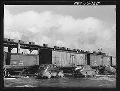 Refrigerator cars waiting to be iced at the icing station of the Indiana Harbor Belt Railroad. The little carts on the platform are used for carrying the crushed ice up and down the platform and dumping it down the chutes into the cans