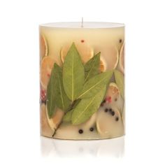 Our botanical candles are filled with real fruit, shells, spices, and other natural elements. As the candle burns down the middle, the botanicals encased in the wax are gorgeously illuminated. A subli