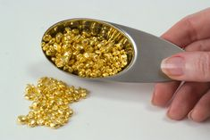 99.99% pure Fine Gold granules. These are used to melt and pour the ingots/bars which are on this board. to veiw a 1oz ingot/bar being poured follow this link - https://www.youtube.com/watch?v=pF6SB7KFCX4
