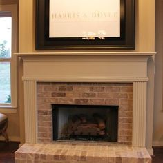 houzz brick fireplaces traditional   Brick Fireplace Surround with Raised Hearth…
