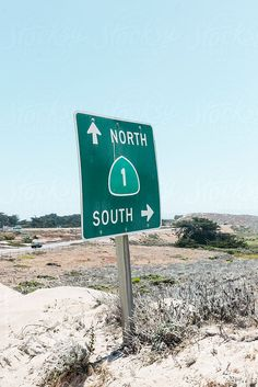 Road sign of Highway 1, pointing north and south by Lilly Bloom. An exclusive image for Stocksy.com.
