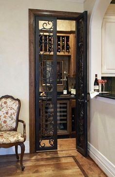 This converted closet for a wine room just off the kitchen is a great idea. Love the wrought iron doors! Converted Closet, Le Closet, Closet Space, Closet Bar, Closet Doors, Entry Closet, Attic Closet, Petits Bars, Home Wine Cellars