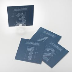 Designed for the mathematician, architect, or engineer, our Blueprint line is a creative twist on traditional seat assignements. Hand-drawn by our own artists, these cards can be ordered in numbers 1-15 or 16-30. Our Blueprint table numbers coordinate perfectly with our Blueprint Placemats and Blueprint Escort Cards.  www.pressedcotton.com