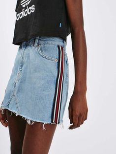 $55 Cute Light Wash Blue Denim Mini Skirt With Printed Striped Side And Black Adidas Cropped Summer Tee