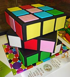 @heatherkirk Harrison might like something like this for his birthday! Rubiks Cube cake - cute idea!