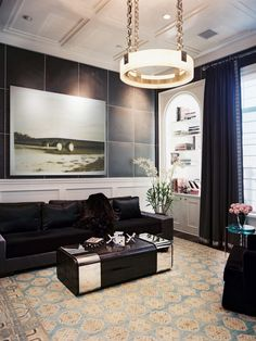 A leather-style finish on the black walls adds a masculine touch in this dramatic lounge space.