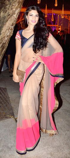 Nude and hot pink sari.