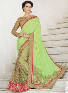 Awesome Green Zari Work Designer Sarees #sarees #desingersarees #bridalsarees #weddingsarees #halfandhalfsarees #netsarees #worksarees #silksarees #georgettesarees  http://www.angelnx.com/Sarees/Bridal-Sarees