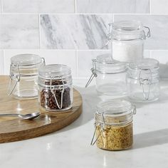 Crate & Barrel Mini Spice Jars with Clamp Set of Six (£8.91) ❤ liked on Polyvore featuring home, kitchen & dining, food storage containers, glass jars, crate and barrel spice jars, crate and barrel jars, glass food storage containers and glass clamp jars