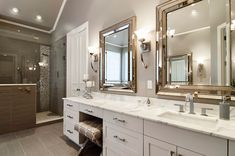 Master Bathroom with High ceiling, travertine tile floors, Calacatta Classic Marble Countertop, Wall sconce, Complex Marble