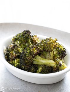 Roasted Broccoli Recipe on SimplyRecipes.com with olive oil, garlic, lemon juice, black pepper, and Parmesan #glutenfree #lowcarb