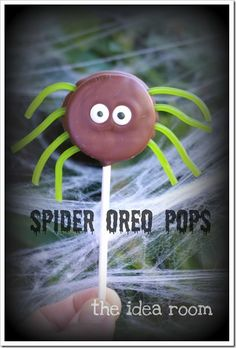 Oreo's dipped in candy melts, with stringed licorice pushed into the sides before the candy sets up. put m's or candy eyes and let cool on wax paper