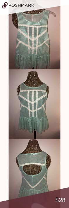 Free People Striped Lace Crochet Peplum Tank Top Green striped peplum Free People tank top with a opening in the back. This shirt is an extra small but it's a large extra small. It's too big on me so I have barely worn this adorable shirt. Perfect for any season and looks great with both shorts and jeans. Let me know if you want more pictures or information. Free People Tops Tank Tops