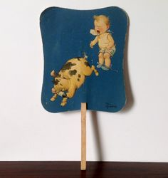 Vintage Paper Advertising Fan C. Create A Cartoon, Baby Pigs, Paper Fans, Christmas Night, House And Home Magazine, Wooden Handles, American Artists, Blue Backgrounds, Vintage Kitchen