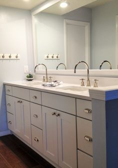 White Shaker Cabinets By Merillat Clic Paired With Chrome Fixtures Is A Go To Look For Any Master Bathroom