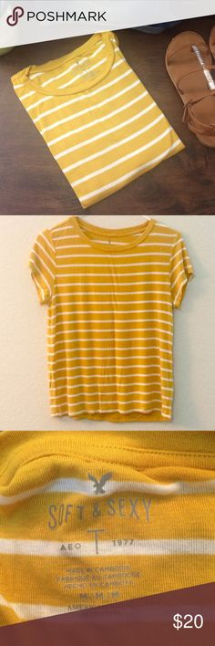 Striped Yellow and White AEO t-shirt Soft and Sexy American Eagle Outfitters T-shirt..bright and peppy. Perfect for a casual day out :) wear it with shorts or wear it with a white skirt, it's sure to brighten up your day :) Worn just once. In perfect condition. Comes from a smoke free home :) American Eagle Outfitters Tops Tees - Short Sleeve