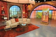 Who can tell me who makes the lamp in the back of this photo? The  one to the right when you are looking at this photo.Rachael Ray Show Season 7 new living room set