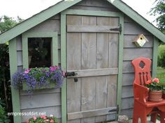 Grey shed with green trim, windowbox, and barn door | Gallery of Garden Sheds