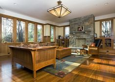 Wooden flooring and furniture craftsman family room prairie style home interior designs