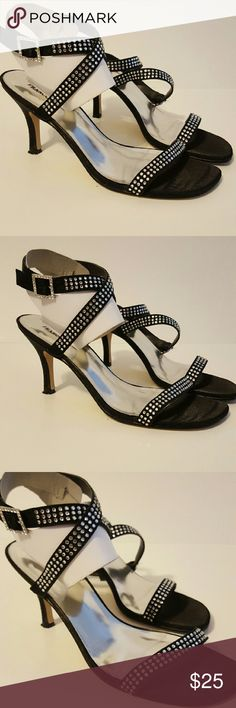 Valenti Franco Black Heeled Sandal These heels are a fun addition to an outfit. They have a Rhinestone detail, a silver footbed and straps that criss cross over the ankle. They have are well kept and show minimal to no damage.  Heel height - 3.5 from floor to heel as shown above Shoes Heels