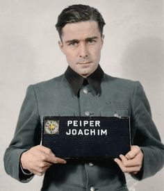 Joachim Peiper (1915-1976) was a an SS-Standartenführer in the Waffen-SS during World War II and personal adjutant to Heinrich Himmler between November 1940 and August 1941. He was charged with war crimes involving the murder of 84 surrendered U.S. troops at the Malmedy massacre in Belgium and accused of other crimes in Italy. He was convicted in the Malmedy case but later paroled. Peiper was assassinated at his home in France in July 1976. (Colorized)
