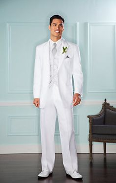 The #groom is looking gregarious in a Pronto Uomo White Two-Button Satin Edge Peak Lapel #tuxedo. #wedding
