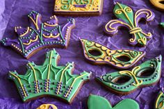 Mardi Gras Cookies ••• An asortment of Mardi Gras cookies featuring mask, crown, and Fleur-de-Lis designs. ••• Get inspired @ http://lifesabatch.com/?p=670