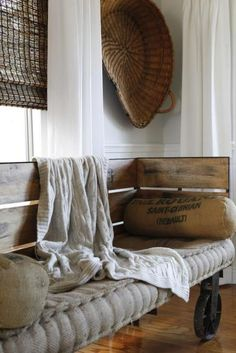Rustic bench with wheels.. Love this cozy little bench!