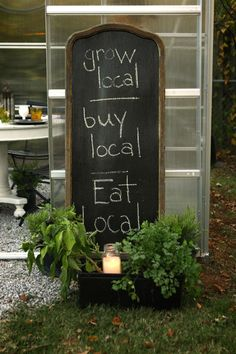 Sustainable Thanksgiving meal, grow local, buy local, eat local, chalkboard sign, greenhouse