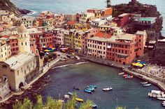 """Cinque Terre"" translates to Five Lands. It is made of five picturesque towns, perched along the rugged cliffside of the Italian Riviera. The coastline, villages, and surrounding hillsides are all par"
