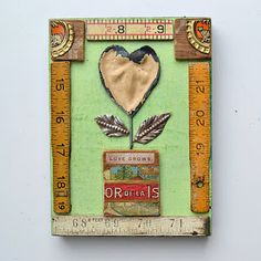 Vintage rulers and graphic accents in this artwork by ElizabethRosenArt - I'd like to make a display like this in tribute to my mother.
