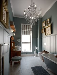 Even a narrow Victorian bathroom can look stunning with an ornate chandelier and rich grey walls  #Victorianbathrooms #bathrooms #bathroomsideas #traditionalbathrooms