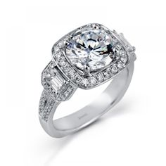 www.diamondvaultonline.com or www.facebook.com/thediamondvault Simon G halo engagement ring