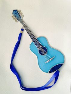 Handmade blue stain glass guitar by Beth. Found at Textures Craftworks Hamilton ON