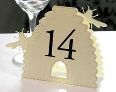 Bee themed table numbers. From http://www.weddingwire.com/wedding-forums/centerpiece-ideas-for-bumble-bee-themed-wedding/babc4340dc9aef8f.html