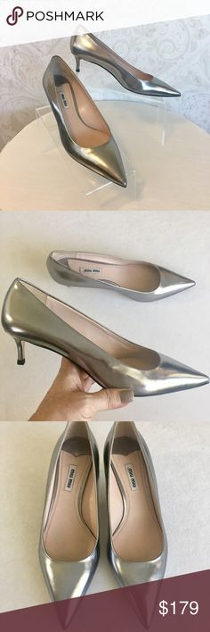 Miu Miu silver metallic kitten heel pumps Beautiful. Metallic silver premium leather. Low covered kitten heel, pointed toe. Gorgeous sleek shape elongates leg without requiring you to sacrifice comfort. One of my favorite pumps from my favorite brand. Gently loved--worn three or four times--but clean and lovely and still in excellent condition. No box, no bags; reflected in price. Miu Miu Shoes Heels