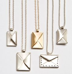 Letter Necklaces. I really want one of these!!!