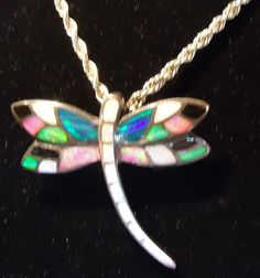 Stunning Sterling Opal Dragonfly Pendant.  Check them out at The Corner Shoppe, 27 Calendar Ave, LaGrange, IL 708-579-2425