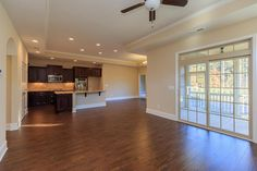View from living room into kitchen and dining room in the Salerno