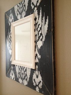 Black ikat frame with red table...hmmm ??
