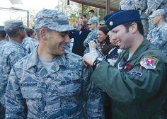 Maj. Stephen Kaminski, left, an F-16 pilot for the South Carolina Air National Guard, has his Ranger tab pinned on his shoulder.