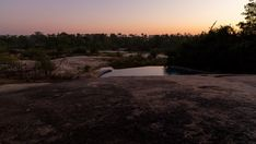 A static timelapse shot from a luxurious African lodge with a private swimming pool at dawn, just before sunrise framed by granite rocks in the foreground. Before Sunrise, Kruger National Park, Hd Video, Stock Footage, Granite, Dawn, Swimming Pools, Rocks, Shots